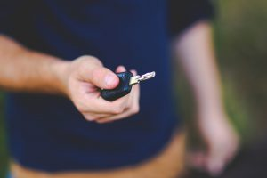 Picture of man with a new car key.