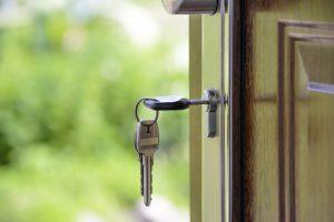 Picture of key in door.