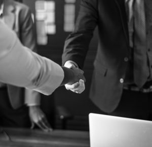 Picture of two people shaking hands.