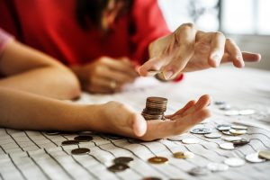 Picture of hand with coins.
